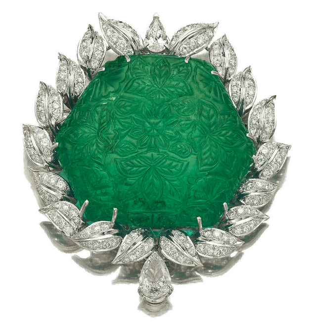 Important carved 178.64ct emerald from the late 17th/early 18th century in a modern diamond frame. Estimate: $307,000 - $511,000 USD.