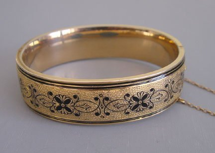 """Betsy Ross"" Victorian Revival gold filled hinged etched bangle with stamped scrolls and black enameling, circa 1935"