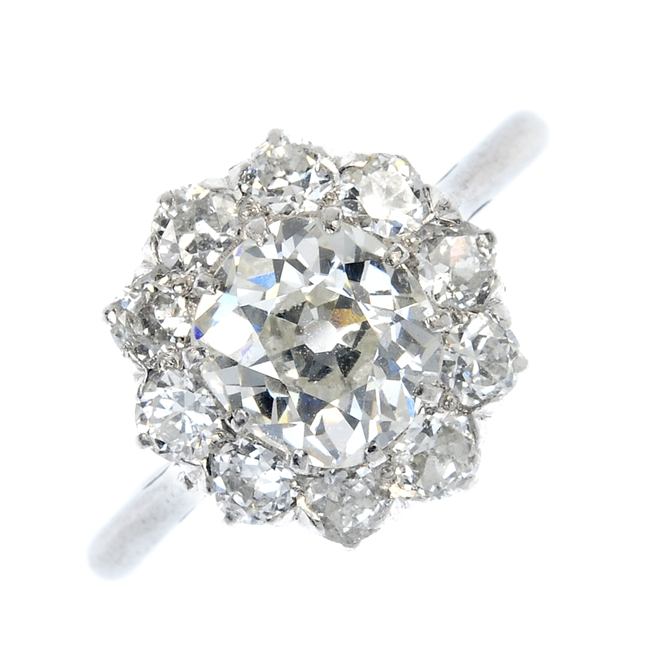 Antique diamond floral cluster engagement ring.