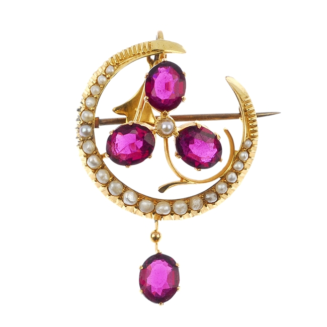 An early 20th century 9ct gold split pearl and garnet pendant.
