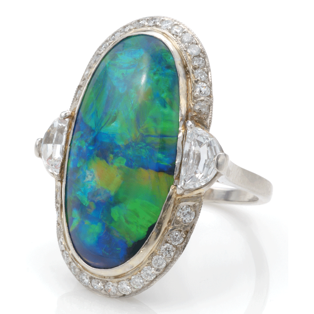 Black opal and diamond cluster ring mounted in platinum.