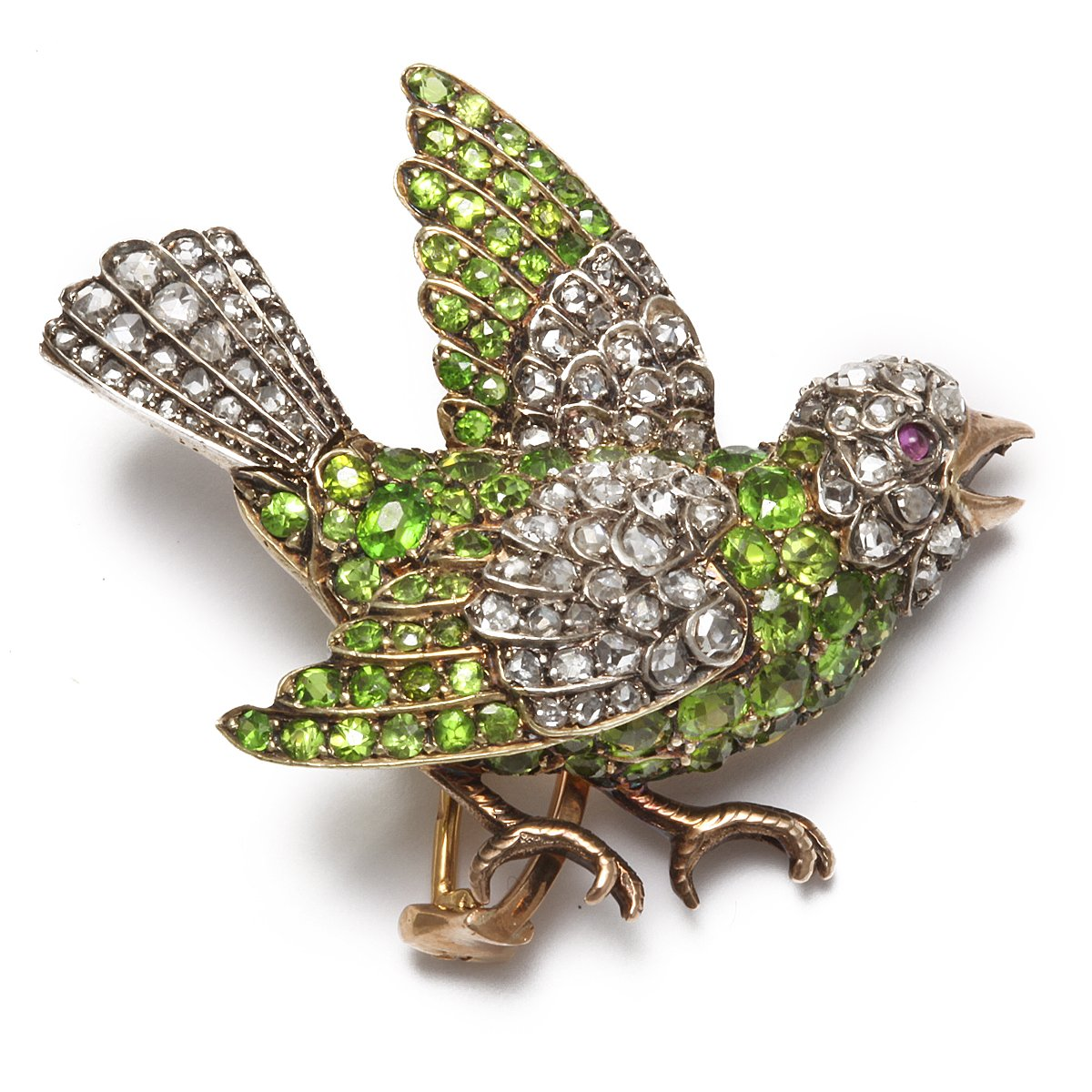 Bird brooch of demantoid garnets and diamonds, with a ruby eye, mounted in silver and gold.